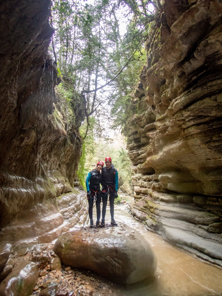 A couple going canyoning together in Ainsa Spain.