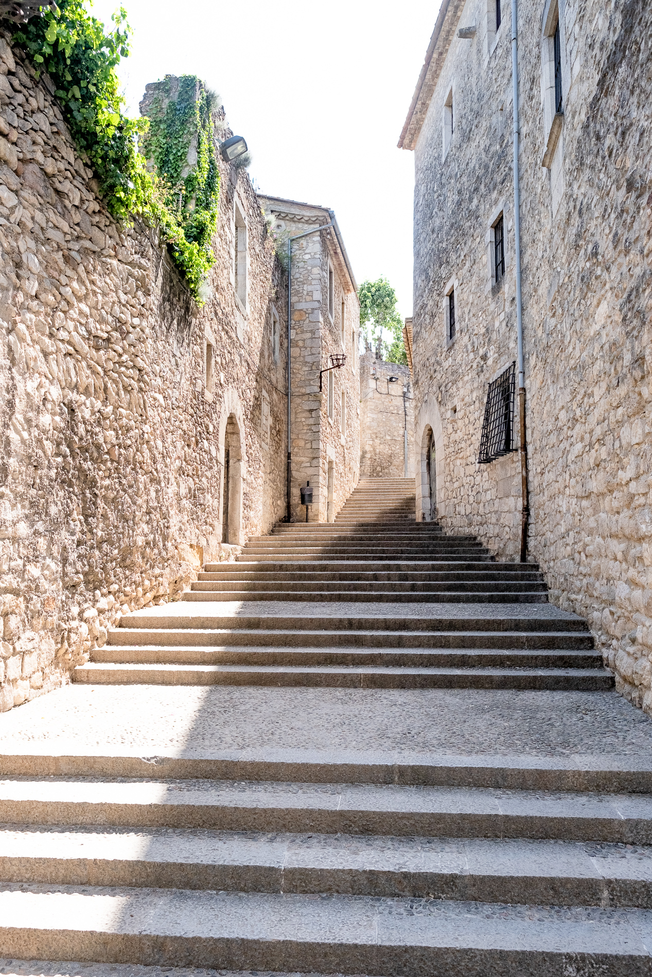 Empty steps in Girona's old town during a free walking tour.